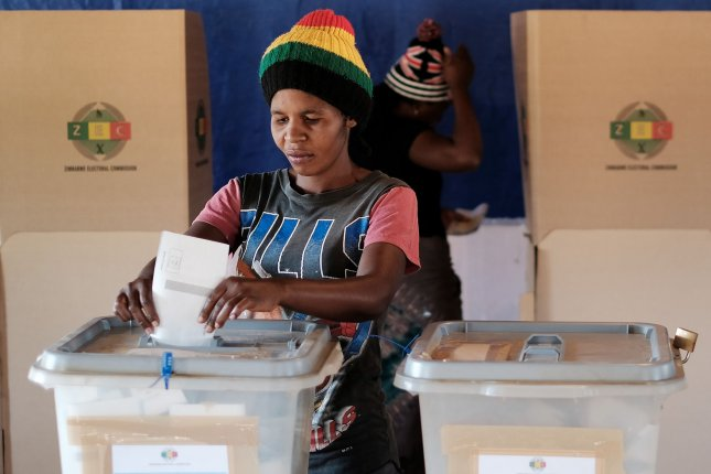 A woman votes at a polling station at Wadzavnayi Farewell Hall B in Mashonaland Central during the 2018 National Elections on Monday. Photo by Jemal Countess/UPI