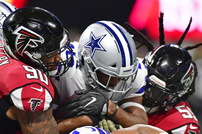 Former Dallas Cowboys running back Alfred Morris (46) is stopped by Atlanta Falcons defenders Derrick Shelby (90) and De'Vondre Campbell (59) on a one yard gain during the first half of an NFL game on November 12 at Mercedes Benz Stadium in Atlanta. Photo by David Tulis/UPI