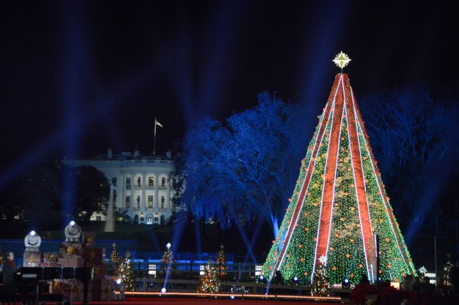 The National Christmas Tree is aglow after being illuminated by President Donald Trump and First Lady Melania Trump on the Ellipse near the White House, on November 28, 2018. An unidentified man climbed 15-20 feet up the tree Friday night. Photo by Mike Theiler/UPI