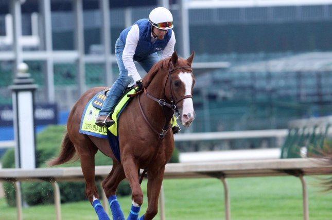 Improbable, the Preakness Stakes favorite at 5-2, trained for the race at Churchill Downs. File Photo by John Sommers II/UPI