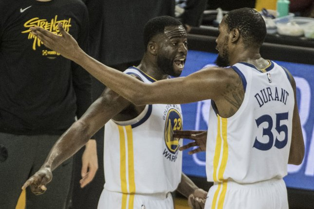 Golden State Warriors forward Draymond Green (L) said former teammate Kevin Durant (R) should have informed the team earlier about his intentions to leave the Warriors last off-season. File Photo by Terry Schmitt/UPI