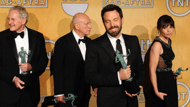 Argo director Ben Affleck (C) appears backstage with cast members after being named Best Ensemble in a Film at the 19th annual SAG Awards held at the Shrine Auditorium in Los Angeles on January 27, 2013. UPI/Jim Ruymen