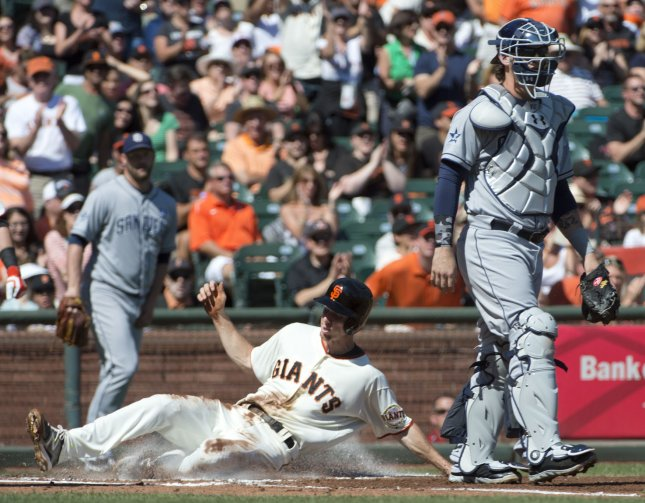799ad564b San Francisco Giants Matt Duffy slides safely home as San Diego Padres  catcher Yasmani Grandal waits for a throw in the first inning at AT T Park  in San ...