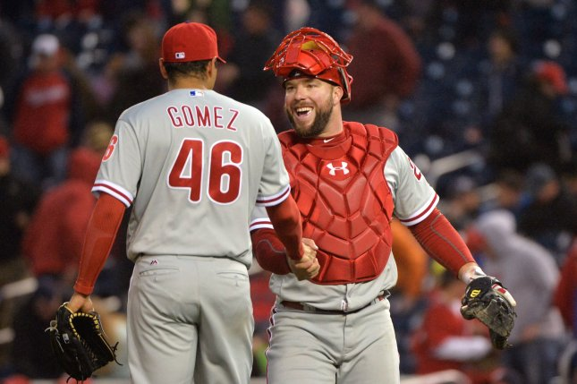Philadelphia Phillies relief pitcher Jeanmar Gomez is congratulated by catcher Cameron Rupp. Photo by Kevin Dietsch/UPI