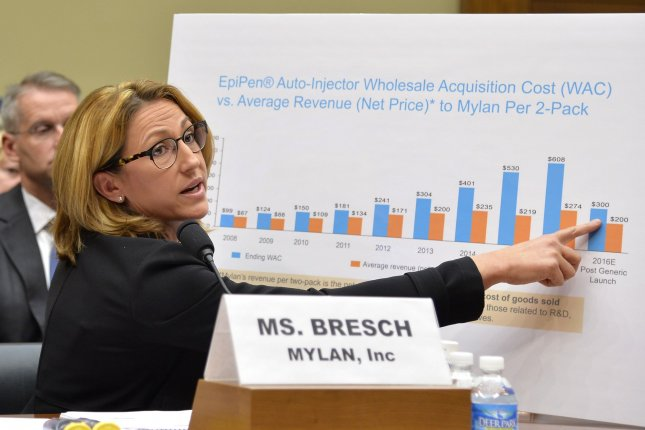 Mylan Inc. CEO Heather Bresch points to a graph chart showing the company's EpiPen cost vs average revenue as she testifies before the House Oversight and Government Reform Committee in Washington on Sept. 21. On Friday, the company agreed to pay $465 million to the government to settle claims it overbilled Medicaid for EpiPen sales for five years, saving the pharma company millions of dollars. Photo by Mike Theiler/UPI