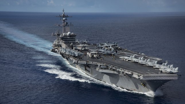 The Nimitz-class aircraft carrier USS Carl Vinson is scheduled to anchor near Vietnam for a four-day port call Monday, the first since the end of the Vietnam War. Photo by MC2 Z.A. Landers/U.S. Navy/UPI