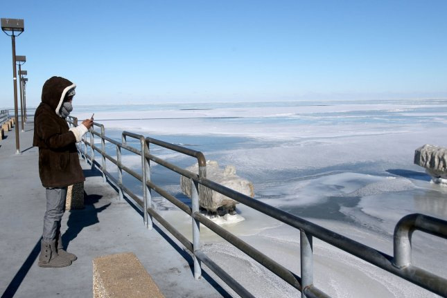 A woman stands on a pier at Edgewater Park on Lake Erie during frigid cold temperatures in Cleveland, Ohio, on January 31. Forecasters said Monday another winter storm will hit the Midwest and Northeast again this week. Photo by Aaron Josefczyk/UPI