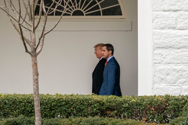 U.S. President Donald Trump walks with Venezuelan opposition leader Juan Guaido down the West Wing Colonnade as he arrives for meeting at the White House in Washington, D.C., on Wednesday. Photo by Ken Cedeno/UPI