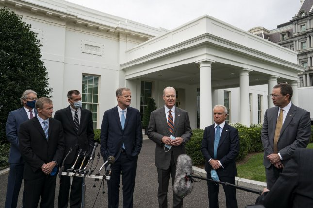 From left to right, Delta CEO Ed Bastian, United CEO Scott Kirby, Hawaiian CEO Peter Ingram, American Airlines CEO Doug Parker, Southwest Airlines CEO Gary Kelly, Airlines For America President Nicholas Calio and Alaska Airlines CEO Brad Tilden speak outside the White House Thursday following a meeting with White House chief of staff Mark Meadows. Photo by Alex Edelman/UPI