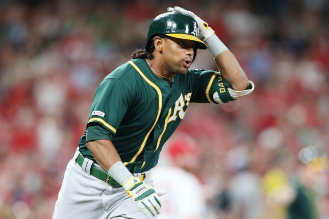 Designated hitter Khris Davis, who was traded in February, will miss the start of the Texas Rangers' season due to his left quad strain. File Photo by Bill Greenblatt/UPI