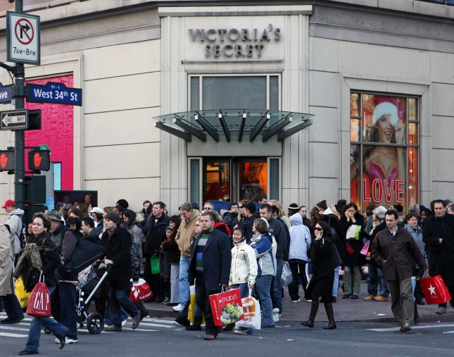 Shoppers crowd the streets outside the Victoria's Secret store in New York City on Black Friday, November 23, 2007. (UPI Photo/John Angelillo) .