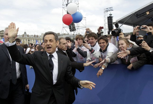 France's President and candidate for re-election in 2012, Nicolas Sarkozy, waves as he arrives for a campaign meeting at the Concorde Plaza, in Paris, France on April 15, 2012. UPI/Michel Euler/Pool