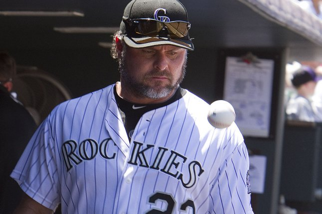 Reserve first baseman Jason Giambi tosses the ball in the dugout before taking the field starting at first base against the Milwaukee at Coors Field in Denver on July 17, 2011. UPI/Gary C. Caskey