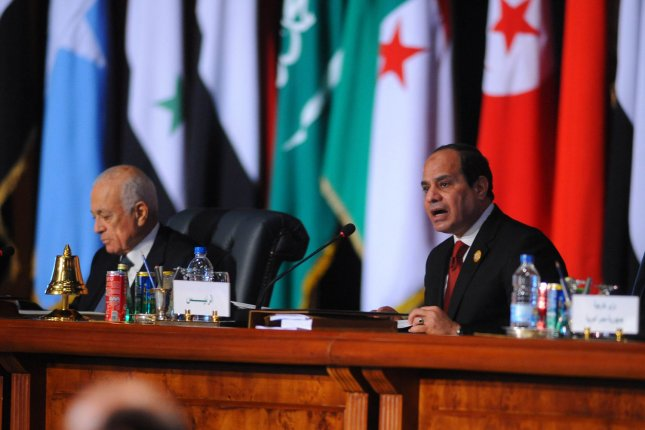 Egyptian President Abdel Fattah al-Sisi (R) approved strict anti-terrorism laws that can punish terrorist-related activity with life imprisonment or the death penalty. File Photo by Egyptian Presidency Office/UPI