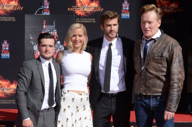 The Hunger Games: Mockingjay - Part 2 cast members Josh Hutcherson, Jennifer Lawrence and Liam Hemsworth and television talk show host Conan O'Brien (L-R) participate in a hand & footprint ceremony in the forecourt of TCL Chinese Theatre in the Hollywood section of Los Angeles on October 31, 2015. Photo by Jim Ruymen/UPI
