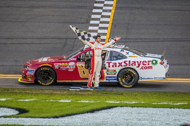 Chase Elliott celebrates winning the 35th annual Powershares QQQ 300 at Daytona International Speedway on Feb. 20. File photo by Edwin Locke/UPI