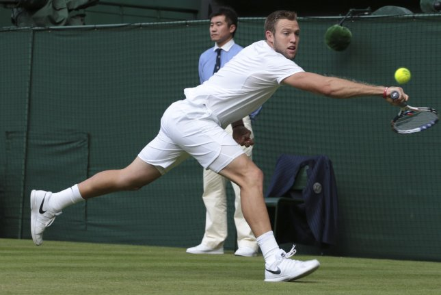 American Jack Sock returns the ball in his match against Canadian Milos Raonic on Day six of the 2016 Wimbledon Championships in Wimbledon, London July 2, 2016. Photo by Hugo Philpott/UPI