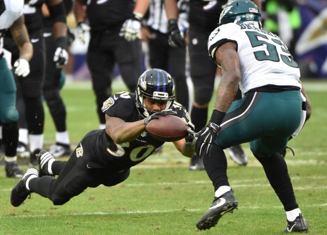 Baltimore Ravens running back Kenneth Dixon recovers a blocked pass during a game against the Philadelphia Eagles in 2016. Photo by David Tulis/UPI