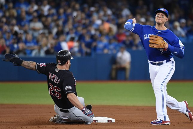 Toronto Blue Jays shortstop Troy Tulowitzki (R) forces Cleveland Indians' Mike Napoli at second base. File photo by Darren Calabrese/UPI
