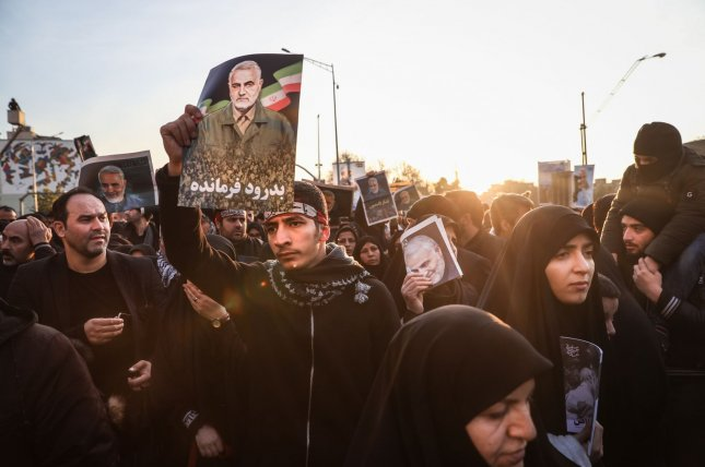 Thousands of mourners pay tribute to Iranian Revolutionary Guards Commander Qassem Soleimani during his funeral Monday in Tehran. Photo by Majid Asgaripour/UPI