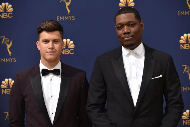 Michael Che (R) confirmed that fellow SNL writer Colin Jost (L) sent a mariachi band to perform for him on his birthday. File Photo by Christine Chew/UPI