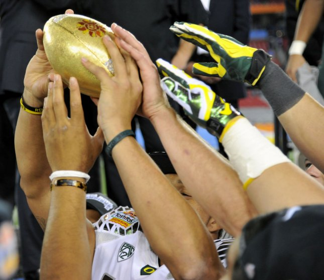Neither criminal background checks nor pre-admission screening questions predict students likely to commit crime on college campuses. Oregon Ducks players' hands can be seen trying to touch the Fiesta Bowl trophy after the Ducks defeated the Kansas State Wildcats 35-17 in the 42nd Fiesta Bowl at University of Phoenix Stadium in Glendale, Arizona, January 3, 2013. UPI/Art Foxall