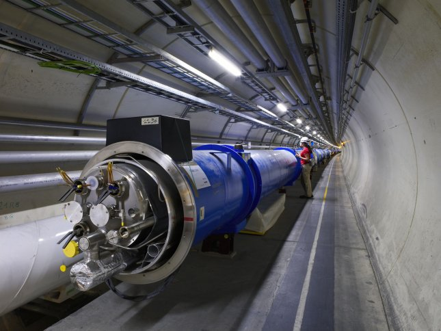 Two Large Hadron Collider (LHC) magnets are seen before they are connected together. The LHC simulates mini-Big Bangs allowing scientists to study theories of the dawn of time. UPI/Maximilien Brice/CERN
