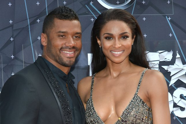 Russell Wilson (L) and girlfriend Ciara at the BET Awards on June 28. File photo by Christine Chew/UPI