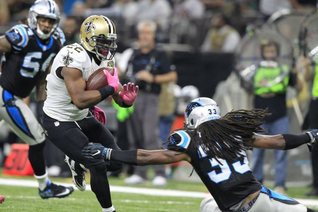 New Orleans Saints running back Mark Ingram (22) runs for 11 yards against the Carolina Panthers at the Mercedes-Benz Superdome in New Orleans October 16, 2016. Defending on the play is Carolina Panthers free safety Tre Boston (33). Photo by AJ Sisco/UPI
