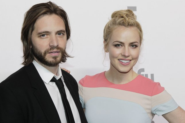 12 Monkeys co-stars Amanda Schull and Aaron Stanford arrive on the red carpet at the 2015 NBCUniversal Cable Entertainment Group Upfront in New York City on May 14, 2015. Their show was renewed for a fourth season Thursday. File Photo by John Angelillo/UPI