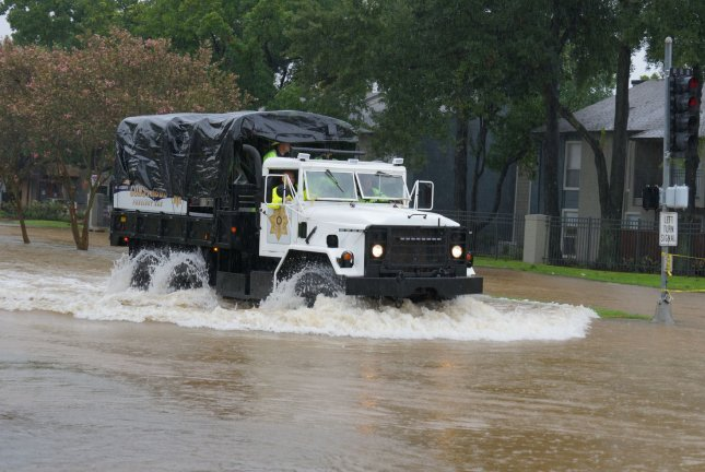 A rescue vehicle traverses flood waters in the Greenspoint Area as Hurricane Harvey was downgraded to a tropical storm, in Houston, Texas on Aug. 27, 2017. Photo by Jerome Hicks/UPI