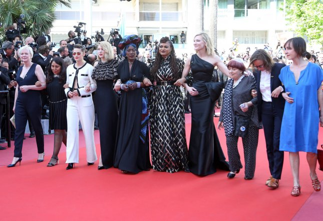 Women filmmakers, including Kirsten Stewart, Lea Seydoux, Khadja Nin, Ava DuVernay, Cate Blanchett and Agnes Varda, arrive on the red carpet protesting how few of them have been honored in the history of the festival during the 71st annual Cannes Film Festival on Saturday. Photo by David Silpa/UPI