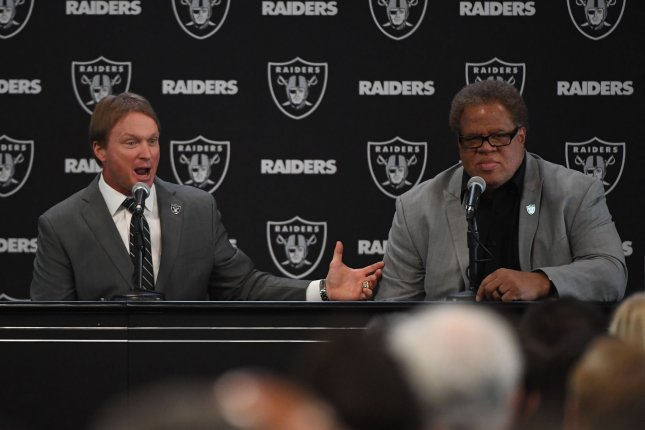 Former Oakland Raiders general manager Reggie McKenzie (R) will join the Miami Dolphins' front office. File Photo by Terry Schmitt/UPI