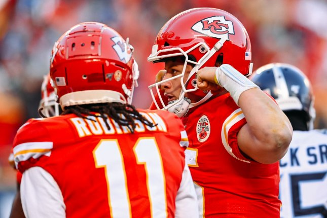 Kansas City Chiefs quarterback Patrick Mahomes (15) flexes his muscles after scoring a touchdown against the Tennessee Titans during the second quarter of the AFC Championship Game on Sunday at Arrowhead Stadium in Kansas City. Photo by Jason Hanna/UPI