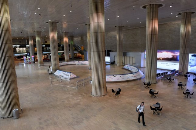 A man walks in an empty arrivals hall in the Ben Gurion Airport in Lod, Israel, near Tel Aviv, on Wednesday. Photo by Debbie Hill/UPI