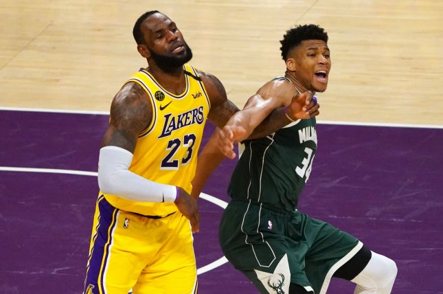 Los Angeles Lakers forward LeBron James (L) and Milwaukee Bucks forward Giannis Antetokoumpo fight for position during a game at Staples Center in Los Angeles, Calif., on March 6, five days before the season was interrupted by the coronavirus pandemic. Photo by Jon SooHoo/UPI