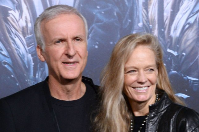 Director James Cameron (L) and his wife, Suzy Amis, attend the premiere of The Hobbit: The Battle of Five Armies on December 2014. Disney has delayed the release of Cameron's Avatar sequels along with a collection of untitled Star Wars films. File Photo by Jim Ruymen/UPI