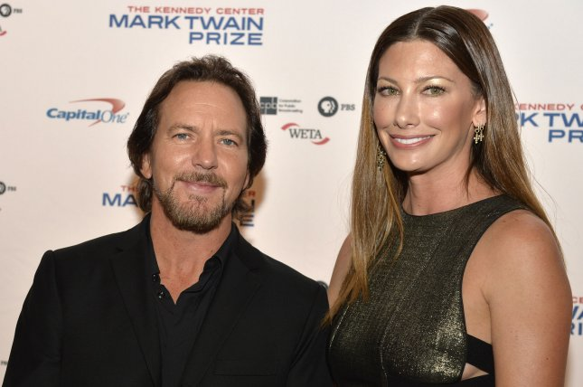 Pearl Jam frontman Eddie Vedder (L) and his wife, Jill McCormick, arrive at the John F. Kennedy Center for the Performing Arts in October 2017. Pearl Jam is headlining another weekend of the Ohana Festival. File Photo by Mike Theiler/UPI