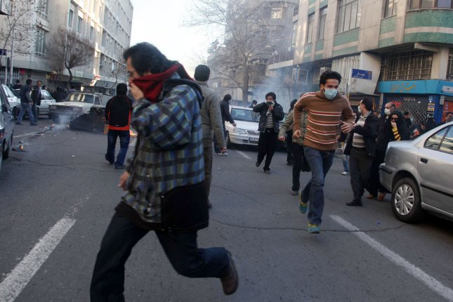 Iranian protesters run from police during an anti-government protest in Tehran, Iran on February 14, 2011. Last week protests led to the downfall of Egyptian President Hosni Mubarak's government. UPI/STR