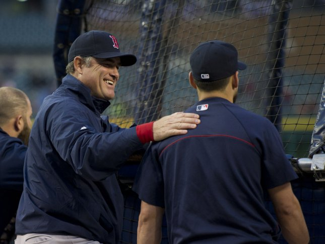 Boston Red Sox Manager John Farrell (L), shown during batting practice on Oct. 16, will keep the same 25-men roster the Red Sox used in their ALCS win for thw 2013 World Series, which begins Wednedsay against the St. Louis Cardinals. UPI/Brian Kersey