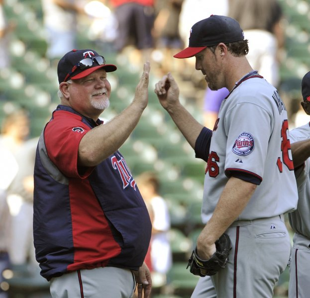 Minnesota Twins manager Ron Gardenhire (L) and relief pitcher Joe Nathan celebrate their win over the Chicago White Sox at U.S. Cellular Field on August 31, 2011 in Chicago. The Twins won 7-6. UPI/Brian Kersey