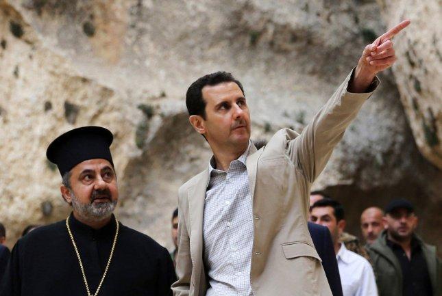 In this photo released by Syria's national news agency, Syrian President Bashar al-Assad visits the Christain town of Maaloua, northeast of Damascus, in Syria on April 20, 2014. The Syrian leader visited the recaptured town of Maaloula on Easter Sunday as he seeks to persuade minorities that the government is their best protection against hardline Islamists. UPI