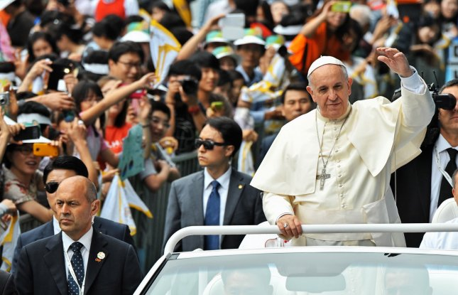 Pope Francis, seen here in South Korea in August, will marry 20 couples at the Vatican Sunday. UPI/Keizo Mori