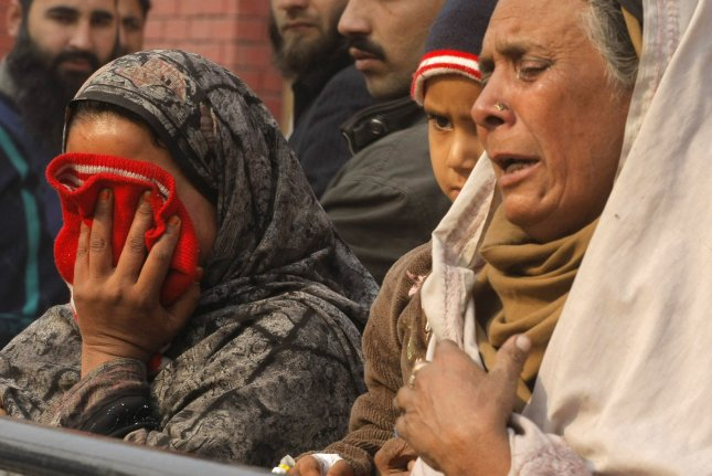 Relatives of injured students react as they arrive at a hospital dealing with the victims of an attack by Taliban gunmen on a school in Peshawar, Pakistan on December 16, 2014. Taliban insurgents killed more than 140, mostly students, in a morning terrorist attack on the military-run school in northwest Pakistan. UPI/Sajjad Ali Queshi