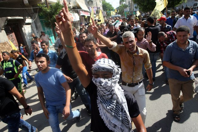 Palestinian mourners chant slogans against Israel during the funeral procession of 13-year-old Marwan Barbakh, in Khan Younis, in southern Gaza, on Oct. 11, 2015. Two Palestinian teenagers were killed and 10 people wounded by Israeli fire during stone throwing clashes yesterday at the Gaza border fence, emergency medical services in the coastal enclave said. Photo by Ismael Mohamad/UPI