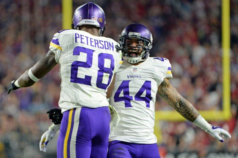 Minnesota Vikings' Adrian Peterson (L) and Matt Asiata. Photo by Art Foxall/UPI