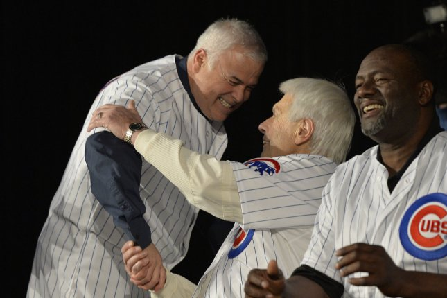 Chicago Cubs manager Rick Renteria (L) shakes hands with former Cubs pitcher Milt Pappas at the 29th Annual Cubs Convention in Chicago on January 17, 2014. UPI/Brian Kersey