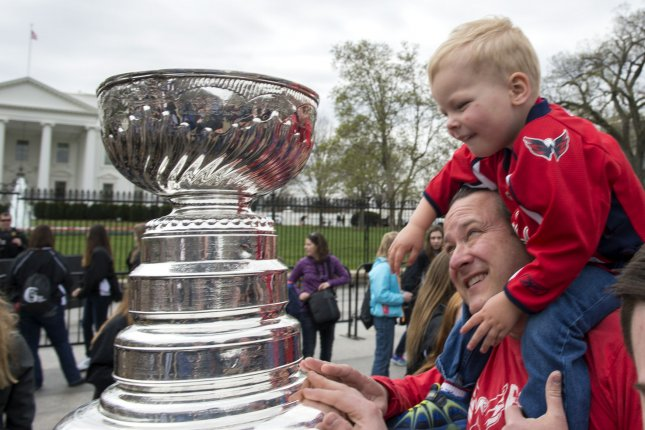 Fans get up close to the Stanley Cup recently when it was in Washington, D.C. Teams are hoping to get their name carved in it soon. File photo by Pat Benic/UPI