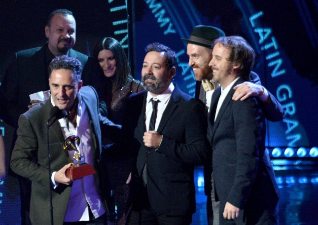 Left to right, Jorge Drexler, Carles Campi Campon, Jesus Martos and Pablo Martin Jones accept the Record of the Year award for Telefonia onstage during the 19th annual Latin Grammy Awards Thursday. Photo by Jim Ruymen/UPI