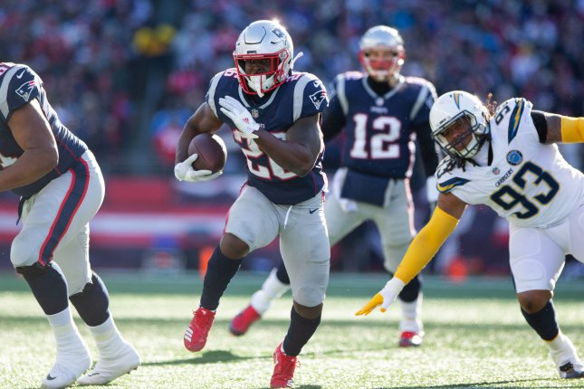 New England Patriots running back Sony Michel (26) finds an opening on 14-yard touchdown run in the first quarter against the Los Angeles Chargers in the AFC Divisional playoff game on Sunday at Gillette Stadium in Foxborough, Mass. Photo by Matthew Healey/UPI